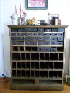 quirky old apothecary - I am a sucker for apothecary cabinets.  Love this website - is it the new craigslist?