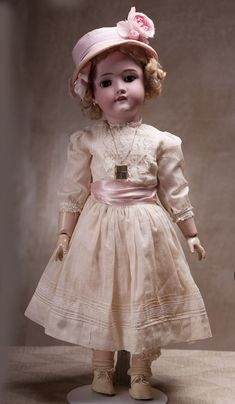 "Antique German Bisque child doll by Kley & Hahn. Ball jointed, open mouth, 26"", which is large for a child doll."