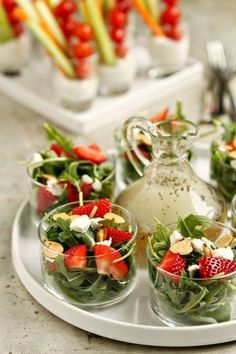 Strawberry Salad with Poppyseed Dressing. When it's hot outside, there's nothing better than a crisp, cool salad. One of my favorites is an arugula salad with strawberries, goat cheese and almonds topped with a homemade poppyseed dressing. Snacks Für Party, Appetizers For Party, Appetizer Salads, Lunch Party Ideas, Party Salads, Tea Party Recipes, Salad Bar Party, Tea Party Foods, Individual Appetizers