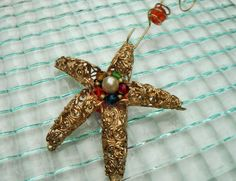 Hey, I found this really awesome Etsy listing at https://www.etsy.com/listing/210600139/gold-star-ornament-starfish-ornament