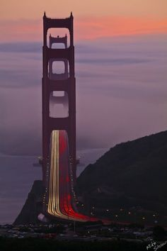 """ the Golden Gate Bridge is always  beautiful"". what a view. Is that the fog rolling in? We better hurry to our own party""....................."
