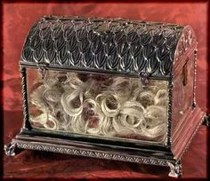 reliquary containing the hair of St. Clare, shorn by the hand of St. Francis, on the night she ran away from home to join his community