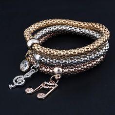 Set of 3 bracelets - Gold Plated Crystal Chain Bracelets with Treble Clef Charmes #3set #crystal #bracelets #charms #metalbracelets # chokerpendantcom #braceletscharms
