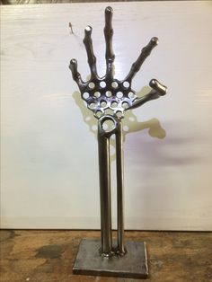 Metal hand sculpture I made from nuts and bolts