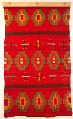 This red Navajo saddle blanket is woven in diagonal twill technique with patterns