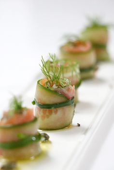 Feeling fancy? Create these little gifts of smoked salmon rolled in cucumber and garnished with dill to bring together the favors.
