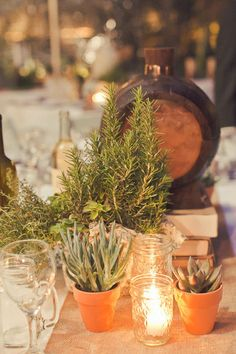 potted thyme and succulents are a great, eco-friendly option to flowers (they'll last well beyond your wedding day) or they can double as wedding favors