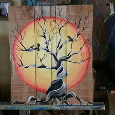 Sunset dead cedar tree and ravens on palletwood  art by Stacie Sheets
