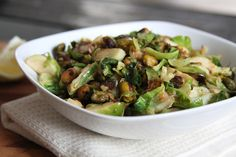 Brussels Sprouts with Pistachios and Lemon | Lattes & Leggings  My husband and I LOVE this recipe for Brussels sprouts.  While the cooking time is really fast and easy, the prep time is a bit longer as we usually peel nearly all of the leaves off the cores before cooking,  After that, it's simple.  Enjoy!