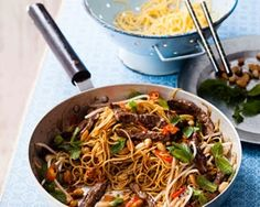 Beef chilli stir fry is a quick meal for two made with egg noodles, garlic, ginger, sirloin steaks and served with peanuts and fresh mint
