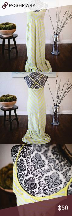 Yellow and gray chevron maxi  by Anthropologie This yellow and gray chevron striped maxi is simple but oh so cute.  I love the crinkled fabric on the bodice that comes up in a V pattern.  The straps come together in a T in the back and are adjustable.  This is just a cute maxi for summer.  I would wear it to see some live music or just meeting some friends downtown for a beer.  17 inches pit to pit and 54 inches in length. This is made by Sunday, Monday, Tuesday, Wednesday, Thursday, Friday…