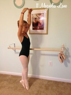 DIY tutorial to make your own ballet barre using items from the hardware store. Easy, inexpensive, and fast project for your little ballerina's room!