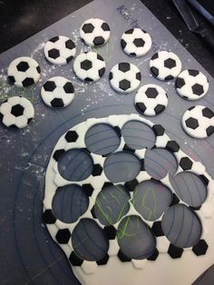 Cutting out sugar paste football cupcake toppers