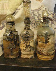 Old glass bottles embellished... Pretty