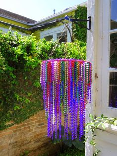 Handmade New Orleans Mardi Gras Bead Gypsy Chandelier. I wanna try to recreate this!
