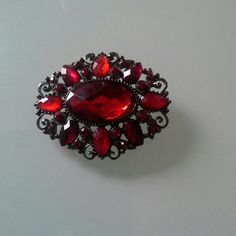Beautiful pin Very pretty brooch.  Deep red in color with metallic black . Jewelry Brooches