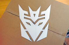 Transformer Stencils and Party Ideas and hand paints on a cardboard wall. Very graffiti