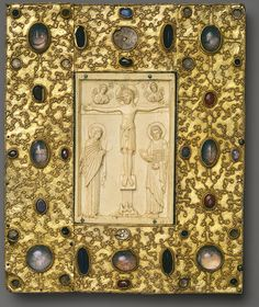 Book Cover with Byzantine Icon of the Crucifixion, Icon carved about 1000, in Constantinople; setting made before 1085 Spanish; From the Convent of Santa Cruz de la Serós, Jaca Gilded silver on a wood backing, inset with ivory icon, sapphire, glass, and crystal