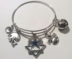 A personal favorite from my Etsy shop https://www.etsy.com/listing/254961216/handcrafted-nfl-charmed-dallas-cowboys