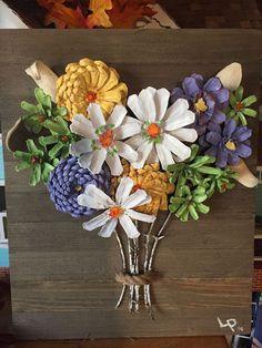 Wood frame w/ pinecone flowers