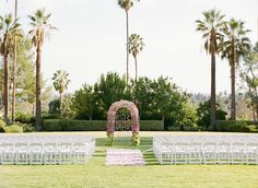 Palm Trees at Ceremony on Grass | Photography: Marisa Holmes. Read More: http://www.insideweddings.com/weddings/a-blissful-and-beautiful-outdoor-fete-in-pasadena-california/513/