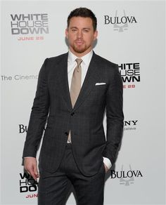 Another good example of suit fit by Channing Tatum and we can see his shirt cuff, which is good.  The tie length ending at the waiste of his pants is correct.