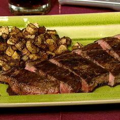 Stanely Tucci's Steak Oregananto  1 1/2 - 2lb top round beef steak   2 tablespoons butter  2 tablespoons olive oil  1/2 cup dry red wine  1/2 teaspoon dried oregano
