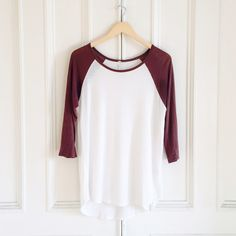 "Baseball Raglan Tee White/brown. 3 quarter length sleeves. Scoop neck. Rounded hem. Length from shoulder: front 28"" ; back 30"". Fits size small. Made of: rayon and spandex. Very soft! Worn only twice. Excellent condition. Tops"
