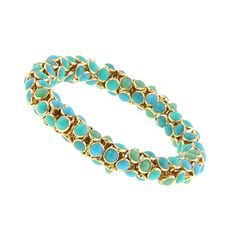 Combining all the colors of the ocean, this slinky bracelet is a refreshing piece to have in your jewelry collection. From our 2028 line, this unique stretch bracelet is made with stacked and rounded hourglass-like beads topped with turquoise, jade green, and teal enameling.