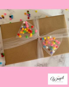 bow filled with mini pom poms, fun, colourful gift wrap for birthdays. Tulle bow filled with mini pom poms fun colourful gift wrap for birthdays.Tulle bow filled with mini pom poms fun colourful gift wrap for birthdays. Birthday Gift Wrapping, Christmas Gift Wrapping, Birthday Gifts, Christmas Gifts, Gift Wrapping Ideas For Birthdays, Cute Gift Wrapping Ideas, Gift Wrapping Bows, Wrapping Papers, Birthday Ideas
