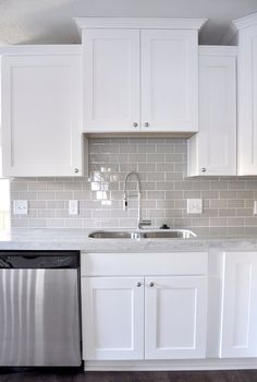 An example of gray subway tile in a white kitchen with white grout. Smoke Gray glass subway tile, white shaker cabinets, pull down faucet - gorgeous contemporary kitchen. Kitchen Cabinets Decor, Kitchen Redo, Kitchen Styling, New Kitchen, Kitchen Dining, Kitchen Ideas, Copper Kitchen, Rustic Kitchen, Kitchen Storage