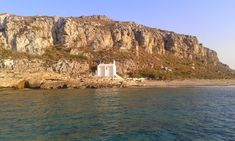 Aglyftis beach and the small church of Saint Patapios at Elafonissos island which is located in southeastern of the Peloponnese, Greece. It lies off the coast of Cape Malea.