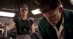 Dina Meyer with suspenders on Starship Troopers