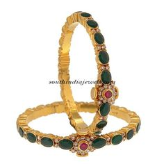 This 22Kt Gold Emerald Bangles are from Price Jewellers. The bangles are studded oval shaped emeralds, rubies and diamonds.
