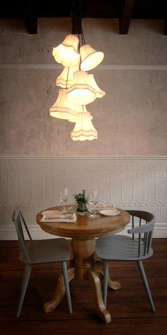 Table for two with great lampshade chandelier.