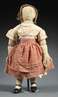 AWESOME.   Skinner.com Auction Sale 2585B - Lot 149.   Folk Art Stuffed Cotton Cloth Doll, reportedly New England origin, second quarter 19th century, hand-stitched doll with sepia ink delineated facial features, padded arms, legs, and body with articulated fingers, wearing original hand-stitched cotton dress and underclothes, velvet and lace trimmed silk bonnet, probably later leather shoes, (wear, toning, staining), ht. 27 1/4 in.