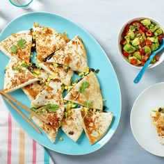 Cooking corn this way adds a depth of flavor from the husk and keeps the kernels from drying out. Tossed together with zucchini and scallions, these quesadillas make for a super-satisfying vegetarian dinner.