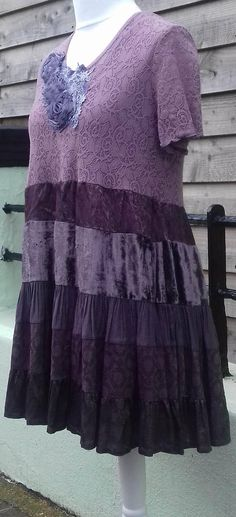upcycled preloved recycled altered clothing plus size tunic dress handmade by dear lisa uk  This is a beautiful and elegant dress with soft lined lace stretchy top and tiered silk and velvet floaty skirt, lovely embellishment at collar. Soft mauve - Deep purple Easy to wear, unique and one of a kind! Measurements: Bust 42 inches laid flat , will stretch comfortably to 52 inches. Waist ( at join, a little above natural waist ) 44 inches Length 35 inches  Please CHECK your measurements…