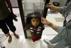 Uninsured patient Donaji Cruz, 3, has her height measured during a health check-up at Venice Family Clinic in Venice, California, June 25, 2009. Some 47 million Americans are uninsured and have little access to the healthcare system. Insurance costs have doubled in under a decade, prompting businesses that provide much of the coverage to complain it threatens U.S. global competitiveness.  REUTERS/Lucy Nicholson (UNITED STATES POLITICS HEALTH IMAGES OF THE DAY) - RTR251D5