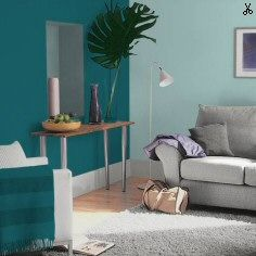 Bright teal living room with Pier 1 Wise Owl Wall Decor I love