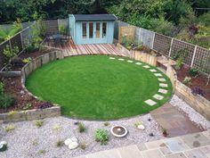 Circular lawn encased by oak sleepers designed by Bushy Business