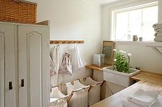 love the idea of wooden counters in the laundry room.  And the sink.  I need the sink.