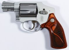 Lot 466: Smith and Wesson Model 642-2 .38 Special Revolver (Serial #CXP5075); Airweight alloy frame with stainless steel barrel and cylinder, five round side break revolver with enclosed hammer, custom S&W grips, original box and paperwork