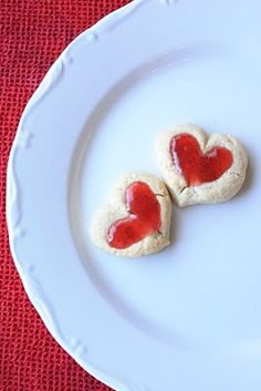 Thumbprint Cookies w/ raspberry jam.  I am going to try this with one of my tried/true recipes. Cute!
