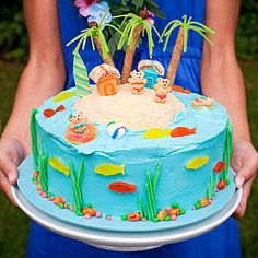 Give kids a taste of the tropics with a luau-theme birthday cake. Use gummy candy, cookies, and cereal to make an edible island.