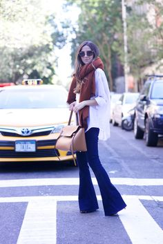 Flared jeans, white blouse