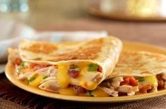 Cowboy Quesadillas recipe - You thought it wasn't possible? The addition of shredded chicken makes these cheesy quesadillas even more satisfying. Mexican Dishes, Mexican Food Recipes, Dinner Recipes, Ethnic Recipes, Mexican Cheese, Lunch Recipes, Yummy Recipes, Free Recipes, Dinner Ideas
