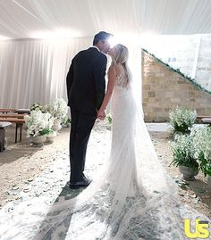 Lauren Conrad shares a romantic kiss with William Tell in a wedding photo from the new issue of Us Weekly!