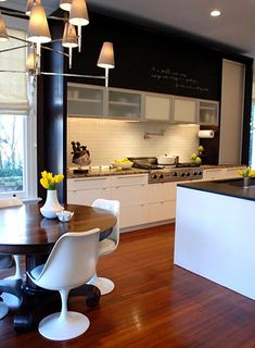 love modern kitchen, this one has gorgeous custom cabinets, nice wood floors nice breakfast nook area