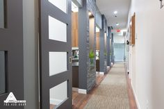 Stacked Slate and Sliding Glass Doors. Dental Office Design by Arminco Inc.